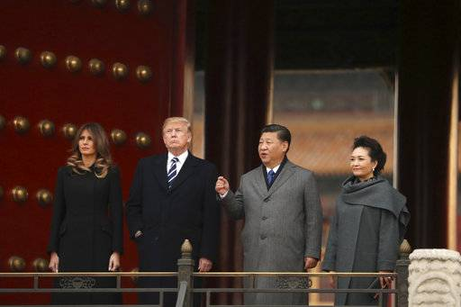 U.S. President Donald Trump, first lady Melania Trump, Chinese President Xi Jinping and his wife Peng Liyuan, right, stand together as they tour the Forbidden City, Wednesday, Nov. 8, 2017, in Beijing, China. Trump is on a five-country trip through Asia traveling to Japan, South Korea, China, Vietnam and the Philippines.
