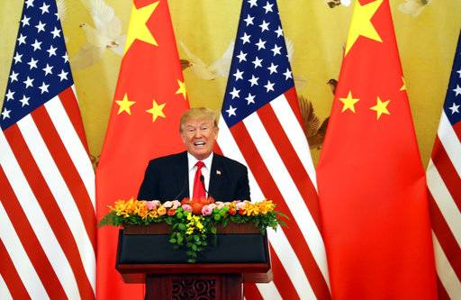 U.S. President Donald Trump speaks during the joint press conference with Chinese President Xi Jinping at the Great Hall of the People in Beijing, Thursday, Nov. 9, 2017.