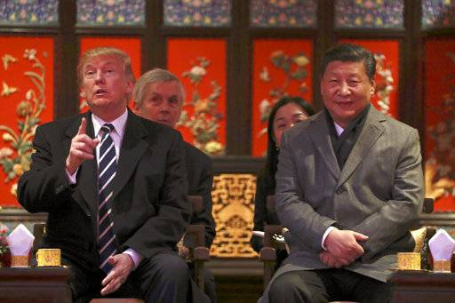 President Donald Trump, left, and Chinese President Xi Jinping, right, arrive for opera performance at the Forbidden City, Wednesday, Nov. 8, 2017, in Beijing, China. Trump is on a five country trip through Asia traveling to Japan, South Korea, China, Vietnam and the Philippines.