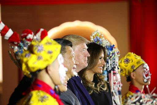 President Donald Trump and first lady Melania Trump stand with Chinese President Xi Jinping during an opera performance at the Forbidden City, Wednesday, Nov. 8, 2017, in Beijing, China. Trump is on a five country trip through Asia traveling to Japan, South Korea, China, Vietnam and the Philippines.