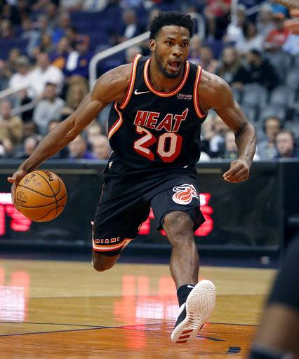 Miami Heat forward Justise Winslow drives against the Phoenix Suns during the first half of an NBA basketball game, Wednesday, Nov. 8, 2017, in Phoenix.