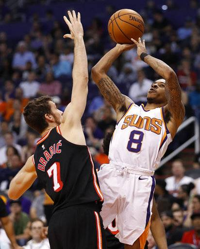 Phoenix Suns guard Tyler Ulis (8) shoots over Miami Heat guard Goran Dragic (7) during the second half of an NBA basketball game, Wednesday, Nov. 8, 2017, in Phoenix.