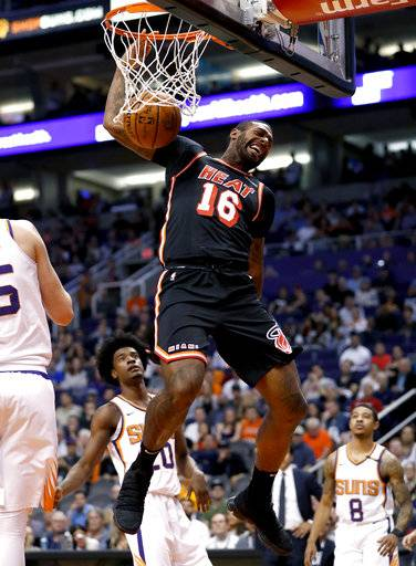 Miami Heat forward James Johnson (16) dunks against the Phoenix Suns during the first half of an NBA basketball game, Wednesday, Nov. 8, 2017, in Phoenix.