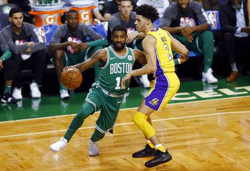 Boston Celtics' Kyrie Irving drives past Los Angeles Lakers' Lonzo Ball during the first quarter of an NBA basketball game in Boston on Wednesday, Nov. 8, 2017.