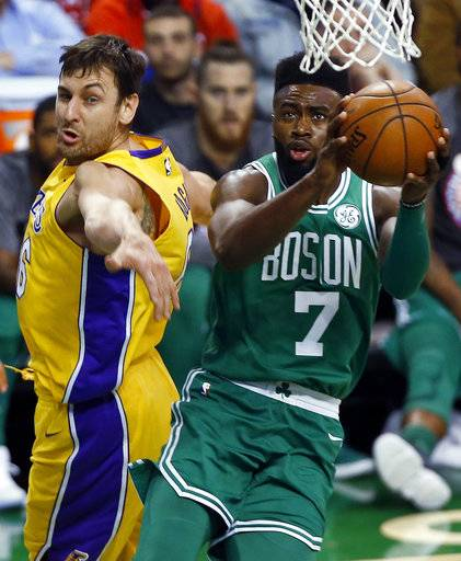 Boston Celtics' Jaylen Brown (7) goes to the basket past Los Angeles Lakers' Andrew Bogut during the first quarter of an NBA basketball game in Boston on Wednesday, Nov. 8, 2017.