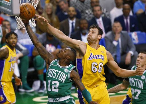 Boston Celtics' Terry Rozier (12) goes to the basket past Los Angeles Lakers' Andrew Bogut during the first quarter of an NBA basketball game in Boston on Wednesday, Nov. 8, 2017.