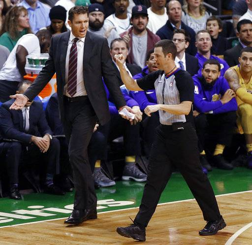 Los Angeles Lakers coach Luke Walton talks with s referee after a foul was called on his team during the first quarter of an NBA basketball game against the Boston Celtics in Boston on Wednesday, Nov. 8, 2017.