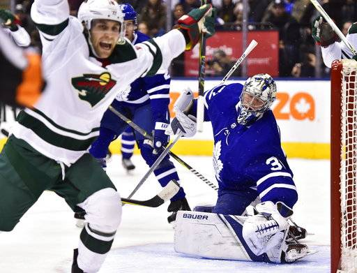 Minnesota Wild left wing Jason Zucker (16) celebrates after scoring on Toronto Maple Leafs goalie Frederik Andersen (31) during the first period of an NHL hockey game Wednesday, Nov. 8, 2017, in Toronto. (Frank Gunn/The Canadian Press via AP)