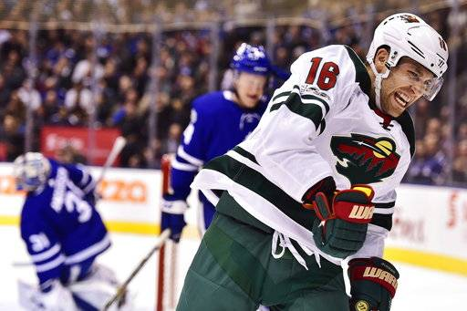 Minnesota Wild left wing Jason Zucker (16) celebrates after scoring on Toronto Maple Leafs goalie Frederik Andersen, left, during the first period of an NHL hockey game Wednesday, Nov. 8, 2017, in Toronto. (Frank Gunn/The Canadian Press via AP)