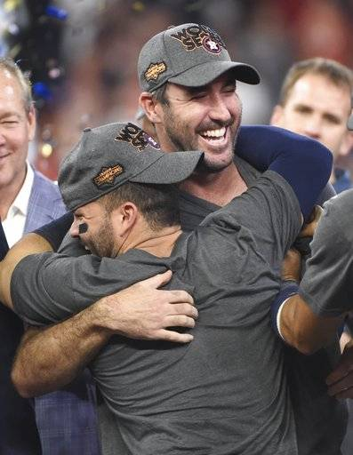 FILE - In this Oct. 21, 2017, file photo, Houston Astros' Justin Verlander hugs Jose Altuve after Game 7 of baseball's American League Championship Series against the New York Yankees in Houston. The Astros won 4-0 to win the series. Verlander and Altuve shared the Babe Ruth award as postseason MVP,  in awards voting by the New York chapter of the Baseball Writers' Association of America
