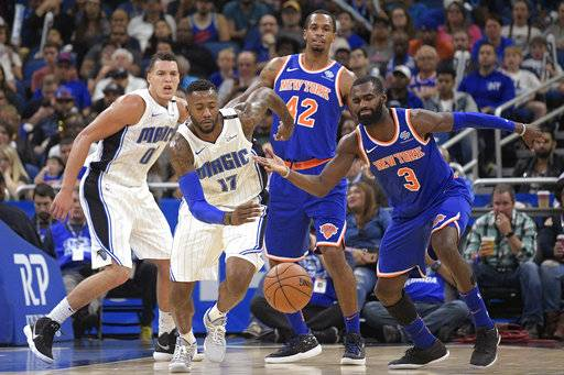 Orlando Magic forward Jonathon Simmons (17) steals the ball from New York Knicks forward Tim Hardaway Jr. (3) during the second half of an NBA basketball game Wednesday, Nov. 8, 2017, in Orlando, Fla. The Magic won 112-99.
