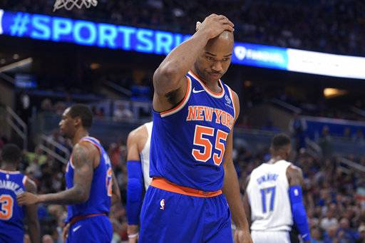 New York Knicks guard Jarrett Jack (55) reacts after a basket by Orlando Magic forward Jonathon Simmons (17) during the second half of an NBA basketball game Wednesday, Nov. 8, 2017, in Orlando, Fla. The Magic won 112-99.