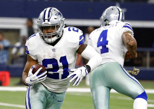 FILE - In this Sunday, Nov. 5, 2017, file photo, Dallas Cowboys running back Ezekiel Elliott (21) carries the ball after taking a hand off from quarterback Dak Prescott (4) during an NFL football game against the Kansas City Chiefs in Arlington, Texas. Elliott and the Cowboys are in legal limbo for the second straight week as the star running back fights his six-game suspension over alleged domestic violence.