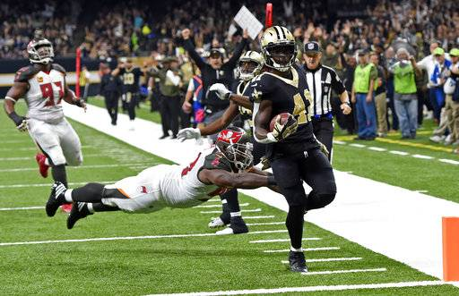 FILE - In this Nov. 5, 2017, file photo, New Orleans Saints running back Alvin Kamara (41) carries for a touchdown past a diving Tampa Bay Buccaneers defensive tackle Clinton McDonald during the first half of an NFL football game in New Orleans. A slew of first- and second-year NFL pros have come of age quickly for the New Orleans Saints. The result has been a six-game winning streak and rising expectations that the Saints might emerge as one of the NFC's premier contenders again after three sub-par seasons.