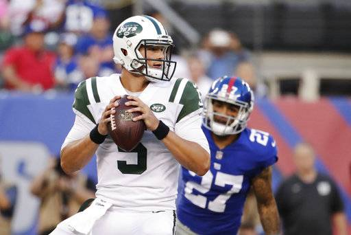 FILE - In this Aug. 26, 2017, file photo, New York Jets quarterback Christian Hackenberg (5) looks to pass during the first half of a preseason NFL football game against the New York Giants in East Rutherford, N.J. Hackenberg remains a big mystery for the New York Jets. The second-year quarterback has yet to take a snap in a regular-season game, and it appears he won't get an opportunity any time soon. Hackenberg is the Jets' No. 3 quarterback, stuck behind backup Bryce Petty and 38-year-old starter Josh McCown.