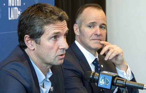 Remi Garde, left, the new head coach of the Montreal Impact, speaks as team president Joey Saputo listens during an MLS soccer news conference in Montreal, Wednesday, Nov. 8, 2017. (Paul Chiasson/The Canadian Press via AP)