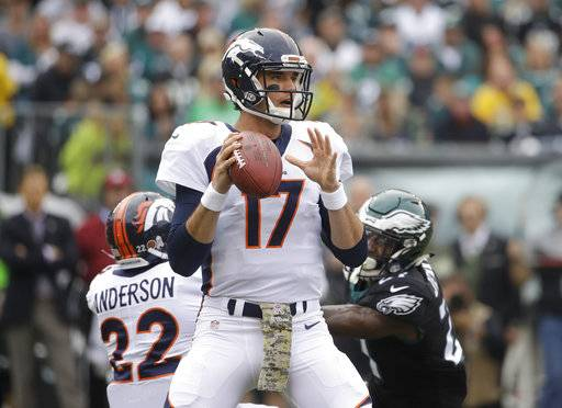 FILE - In this Sunday, Nov. 5, 2017, file photo, Denver Broncos' Brock Osweiler (17) looks to throw against the Philadelphia Eagles during an NFL football game in Philadelphia. Osweiler is expected to start for the Broncos this week against the New England Patriot.