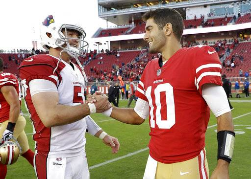 Arizona Cardinals quarterback Drew Stanton, left, greets San Francisco 49ers quarterback Jimmy Garoppolo (10) after an NFL football game in Santa Clara, Calif., Sunday, Nov. 5, 2017.