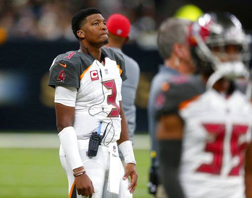 FILE - In this Sunday, Nov. 5, 2017, file photo, Tampa Bay Buccaneers quarterback Jameis Winston (3) watches from the sideline during the second half of an NFL football game against the New Orleans Saints in New Orleans. Winston says consulting Dr. James Andrews about his sore throwing shoulder was ``standard protocol'' and not an indication the injury is worse than he and the Tampa Bay Buccaneers initially believed. The Bucs announced Monday that the third-year pro, who sprained the AC joint in his right shoulder on Oct. 15, will miss at least two games  after re-aggravating the injury during last week's 30-10 road loss at New Orleans.