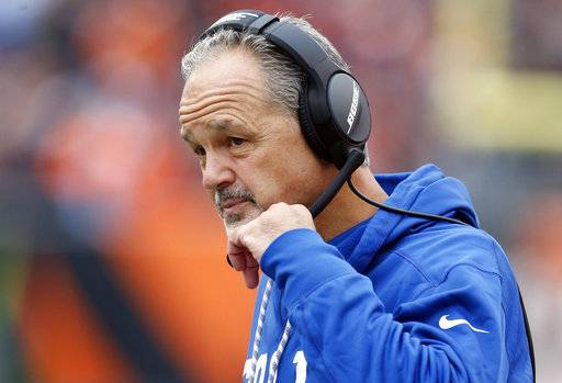FILE - In this Oct. 29, 2017, file photo, Indianapolis Colts head coach Chuck Pagano works the sidelines in the first half of an NFL football game against the Cincinnati Bengals in Cincinnati. Other than Hue Jackson in Cleveland, the fire figures to burn very hot under the Buccaneers' Dirk Koetter; the Giants' Ben McAdoo; the Bengals' Marvin Lewis, whose contract is up this year; yet the Colts' Pagano, could get a pass because he's had no luck with his passer.