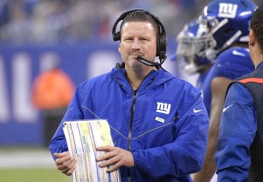 FILE - In this Sunday, Nov. 5, 2017, file photo, New York Giants head coach Ben McAdoo looks on during the second half of an NFL football game against the Los Angeles Rams in East Rutherford, N.J.  With many calling for wholesale changes on the Giants in the wake of a dismal half a season, a relaxed coach Ben McAdoo took a very positive approach with his team heading into this week, telling the players he still believes in them.