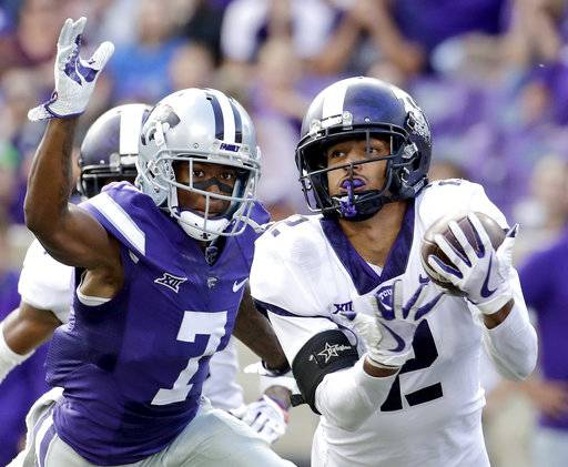 FILE - In this Oct. 14, 2017, file photo, TCU safety Niko Small (2) breaks up a pass intended for Kansas State wide receiver Isaiah Zuber (7) during the second half of an NCAA college football game, in Manhattan, Kan.