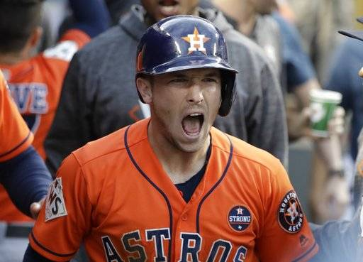 Houston Astros' Alex Bregman reacts after scoring during the first inning of Game 7 of baseball's World Series against the Los Angeles Dodgers Wednesday, Nov. 1, 2017, in Los Angeles.