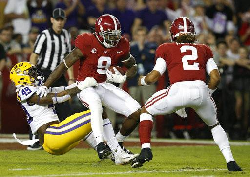 LSU linebacker Arden Key, left, tackles Alabama running back Bo Scarbrough during the first half of an NCAA college football game, Saturday, Nov. 4, 2017, in Tuscaloosa, Ala.