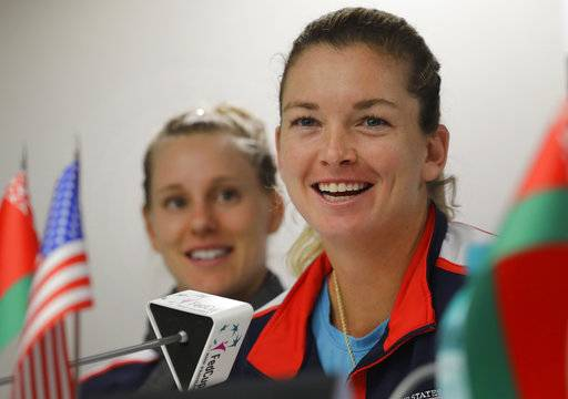 CoCo Vandeweghe, of the US, smiles, as Alison Riske, left, looks on during a press conference prior to the Fed Cup by BNP Paribas Final matches between Belarus and USA, in Minsk, Wednesday, Nov. 8, 2017. The matches will take place Nov. 11 - 12, 2017.