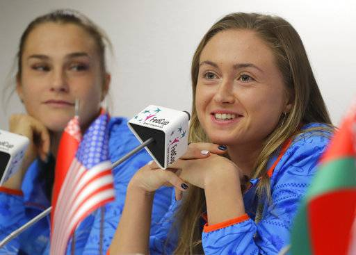 Belarus' Fed Cup team member Aliaksandra Sasnovich, right, speaks, as Aryna Sabalenka looks on during a press conference prior to the Fed Cup by BNP Paribas Final matches between Belarus and USA, in Minsk, Wednesday, Nov. 8, 2017. The matches will take place Nov. 11 - 12, 2017.