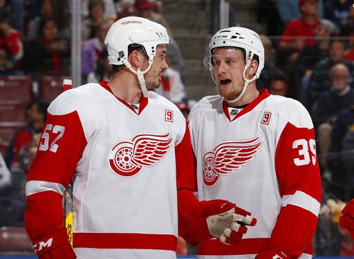 FILE - In this Friday, Dec. 23, 2016 file photo, Detroit Red Wings left wing Anthony Mantha (39) talks to Detroit Red Wings defenseman Jonathan Ericsson (52) during the first period of an NHL hockey game in Sunrise, Fla. The Detroit Red Wings have been fading from elite status in the NHL for nearly a decade and a new arena isn't going to do much to fix their problems. They have a lot of players who belong in the league, but they don't have any stars to lead the franchise back to prominence, Tuesday, Nov. 7, 2017.