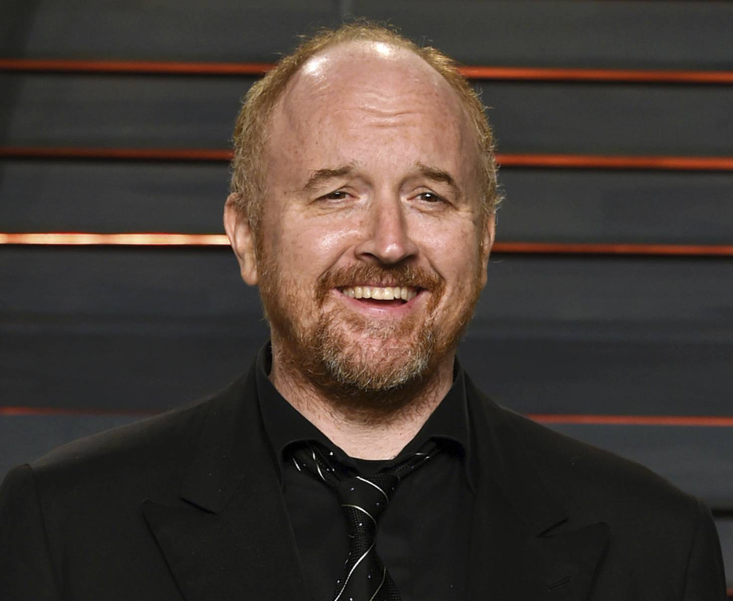 "Louis C.K. arrives at the Vanity Fair Oscar Party in Beverly Hills, Calif. The New York premiere of Louis C.K.'s controversial new film ""I Love You, Daddy"" has been canceled amid swirling controversy over the film and the comedian."