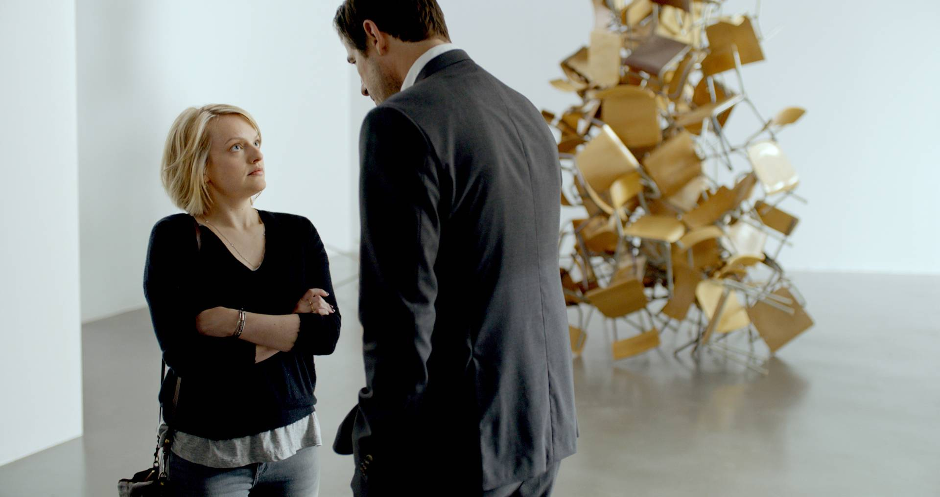 "American journalist Anne (Elisabeth Moss), left, encounters Christian (Claes Bang), chief curator at a Stockholm museum, in ""The Square."""