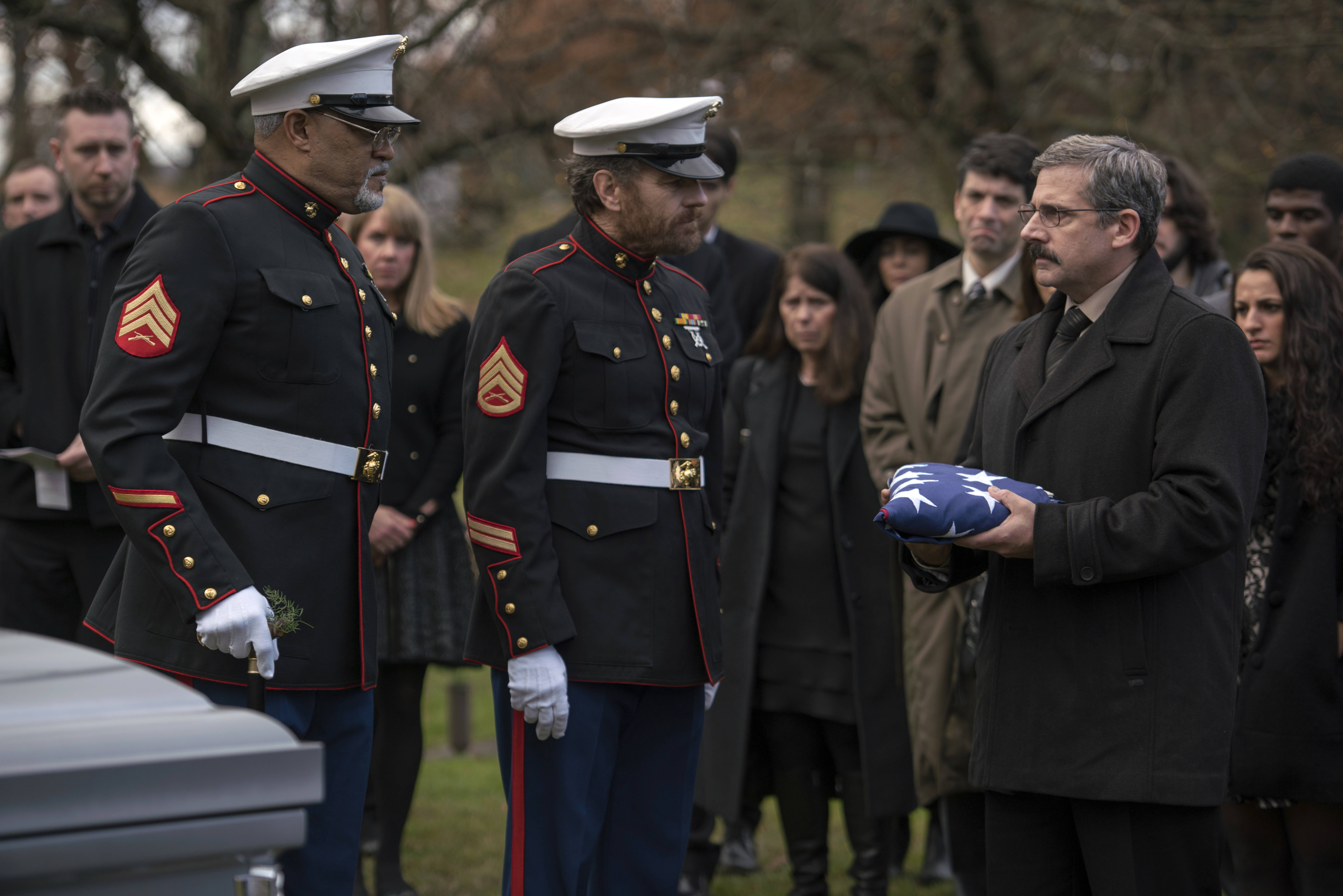 "Two Vietnam War vets (Laurence Fishburne, left, and Bryan Cranston) help a fellow vet (Steve Carell) bury his son in ""Last Flag Flying."""