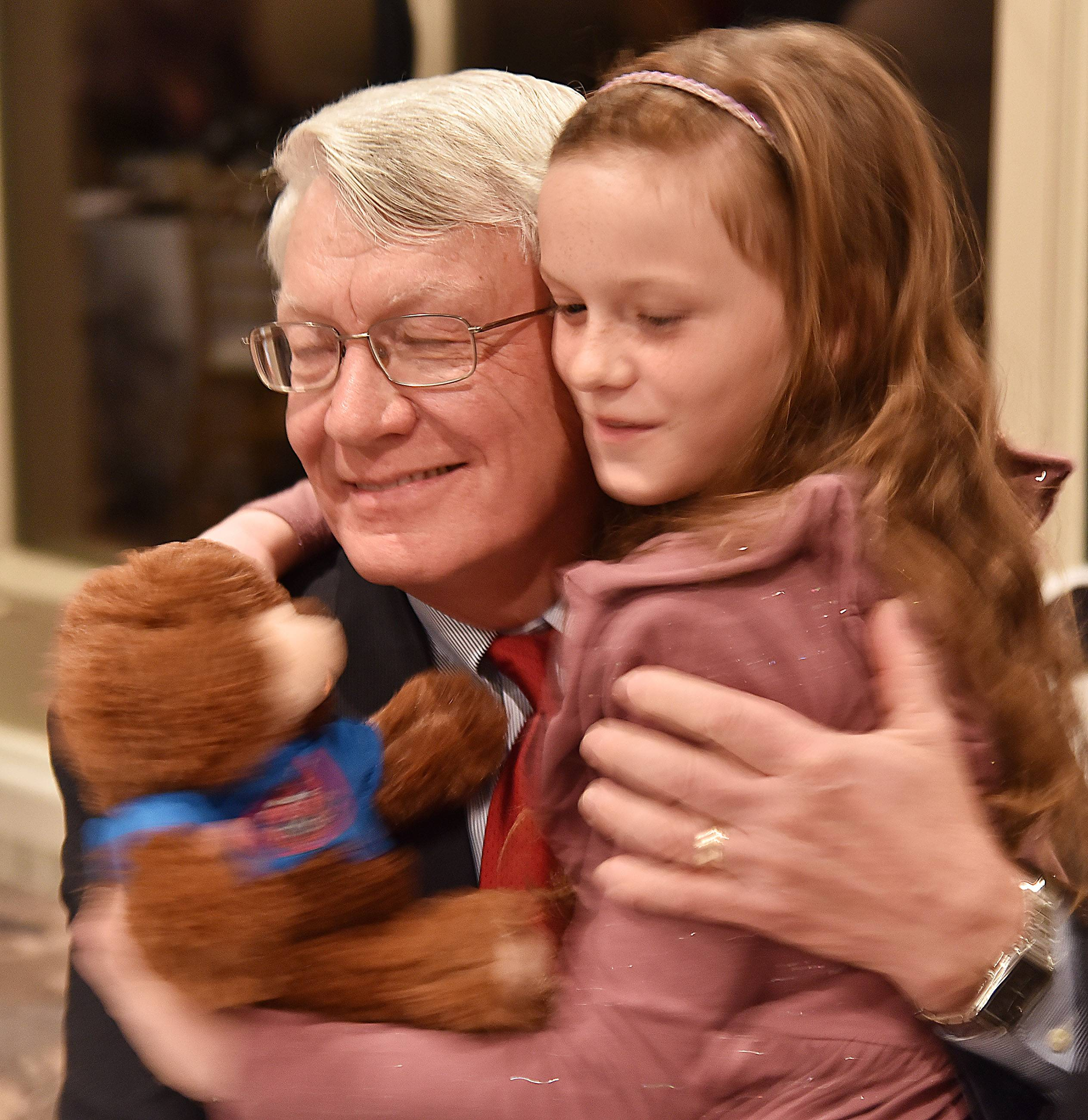 Dean Kilburg gets a hug from his granddaughter, Ava, after receiving the Geneva Chamber of Commerce Wood Community Service Award Thursday night.