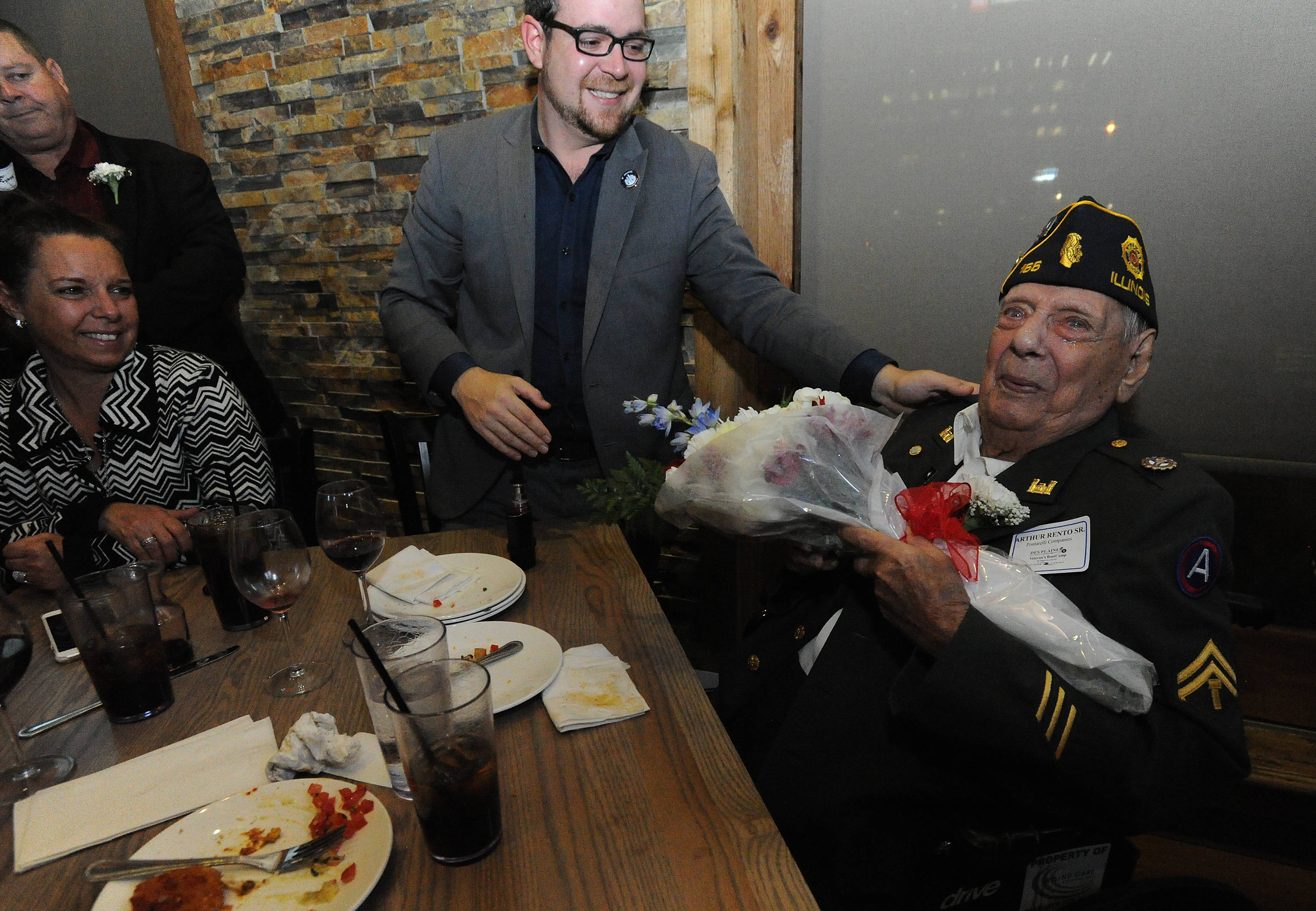 Arthur Rento Sr., 94, of Glenview Corporal with the Army 1st Infantry who served at Normandy, Battle of the Bulge and in the Asian Pacific Campaign was honored at the Des Plaines Chamber of Commerce Veterans ceremony in Rosemont Thursday.