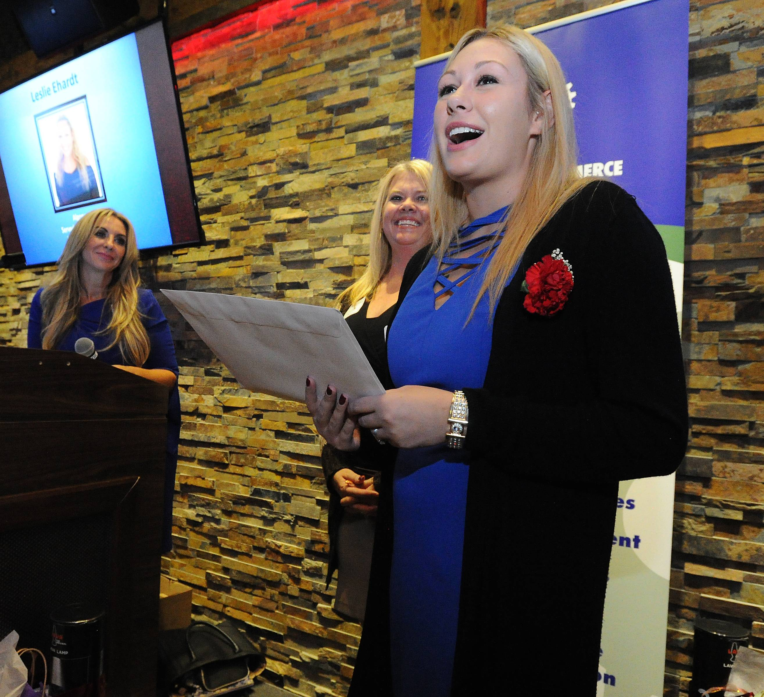 Leslie Ehardt, 23, of Algonquin, who was in the Marines, was honored at the Des Plaines Chamber of Commerce Veterans ceremony in Rosemont Thursday.