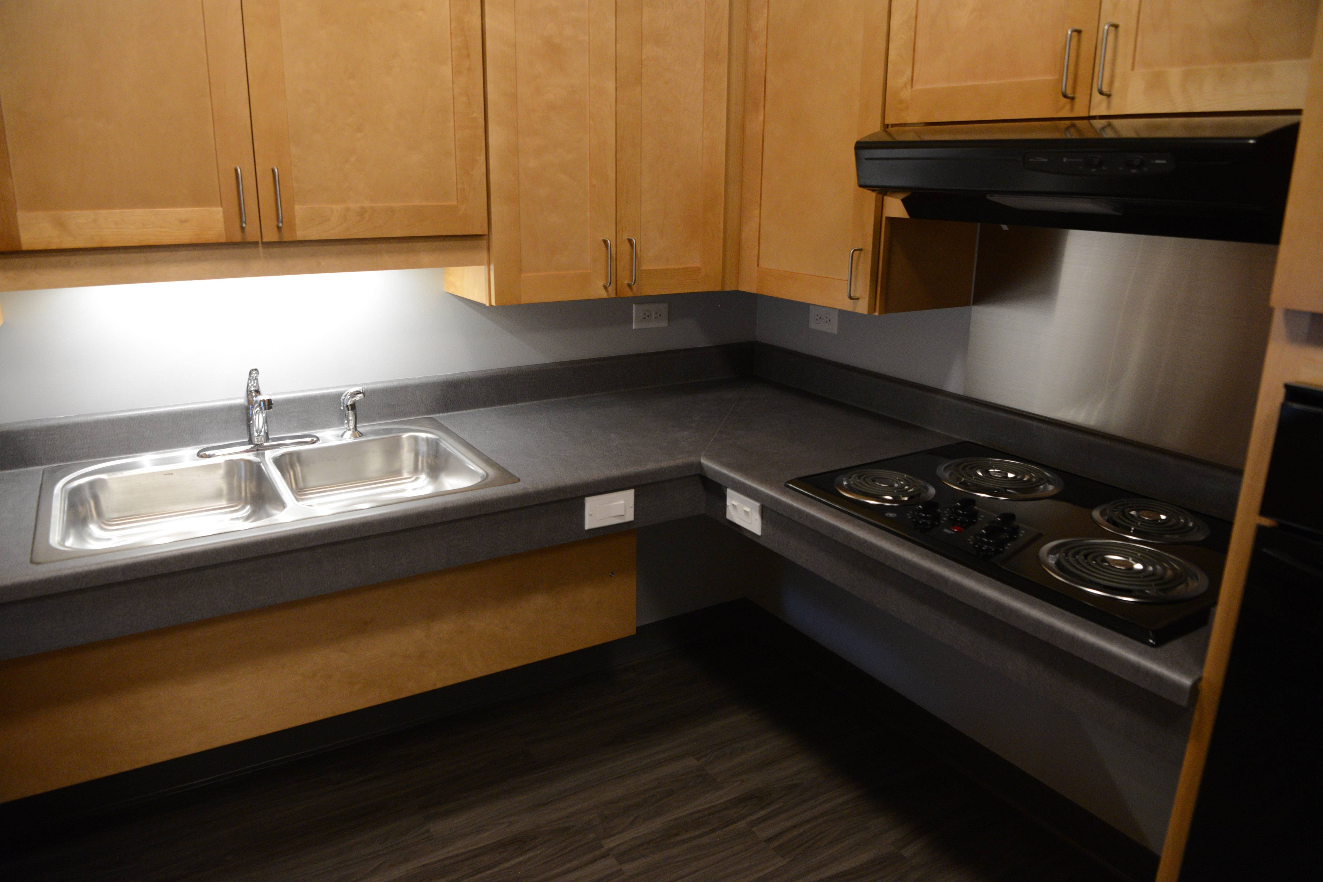 A kitchen of an apartment unit is shown at the Midtown Crossing Apartments on Graceland Avenue in Des Plaines Thursday. Over the Rainbow, an Evanston-based nonprofit, built a four-story, 33-unit apartment building for people with disabilities.