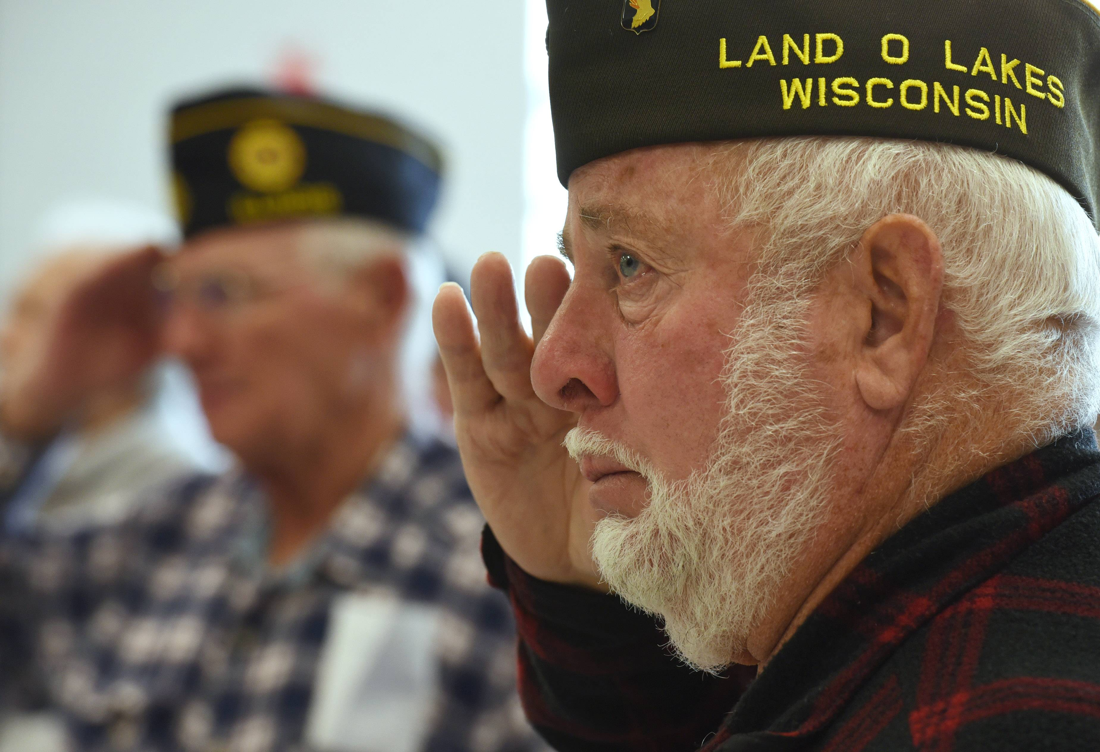 Veteran Richard May of Lindenhurst salutes during the playing of the national anthem at Thursday's Hawthorn Middle School South's annual Veterans Day Breakfast in Vernon Hills. More than 60 area vets attended the event.