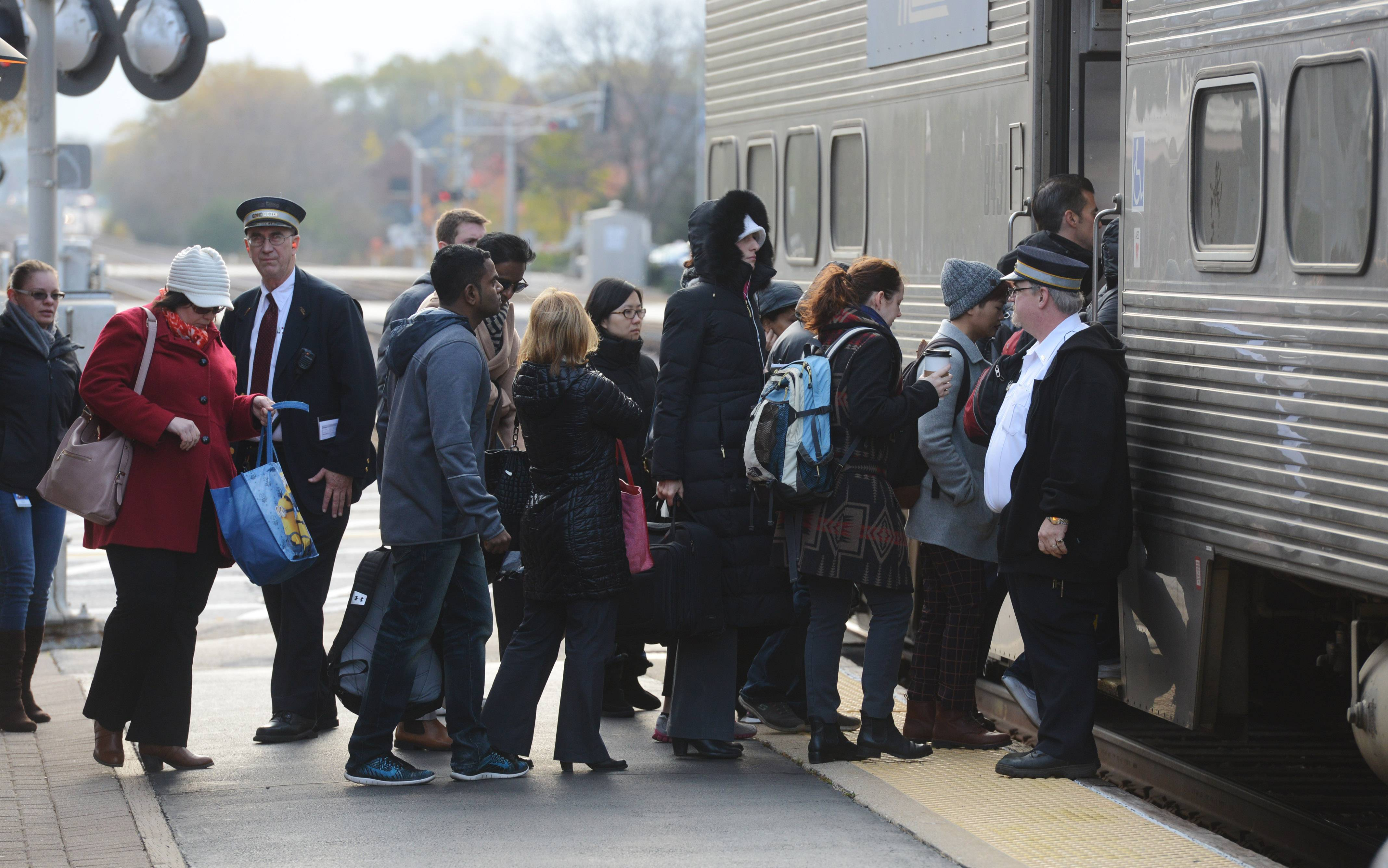 Commuters board a Chicago-bound Metra Union Pacific Northwest Line train at Arlington Heights Thursday morning. The Metra board will vote Friday whether to raise fares, with increases up to 12.6 percent.