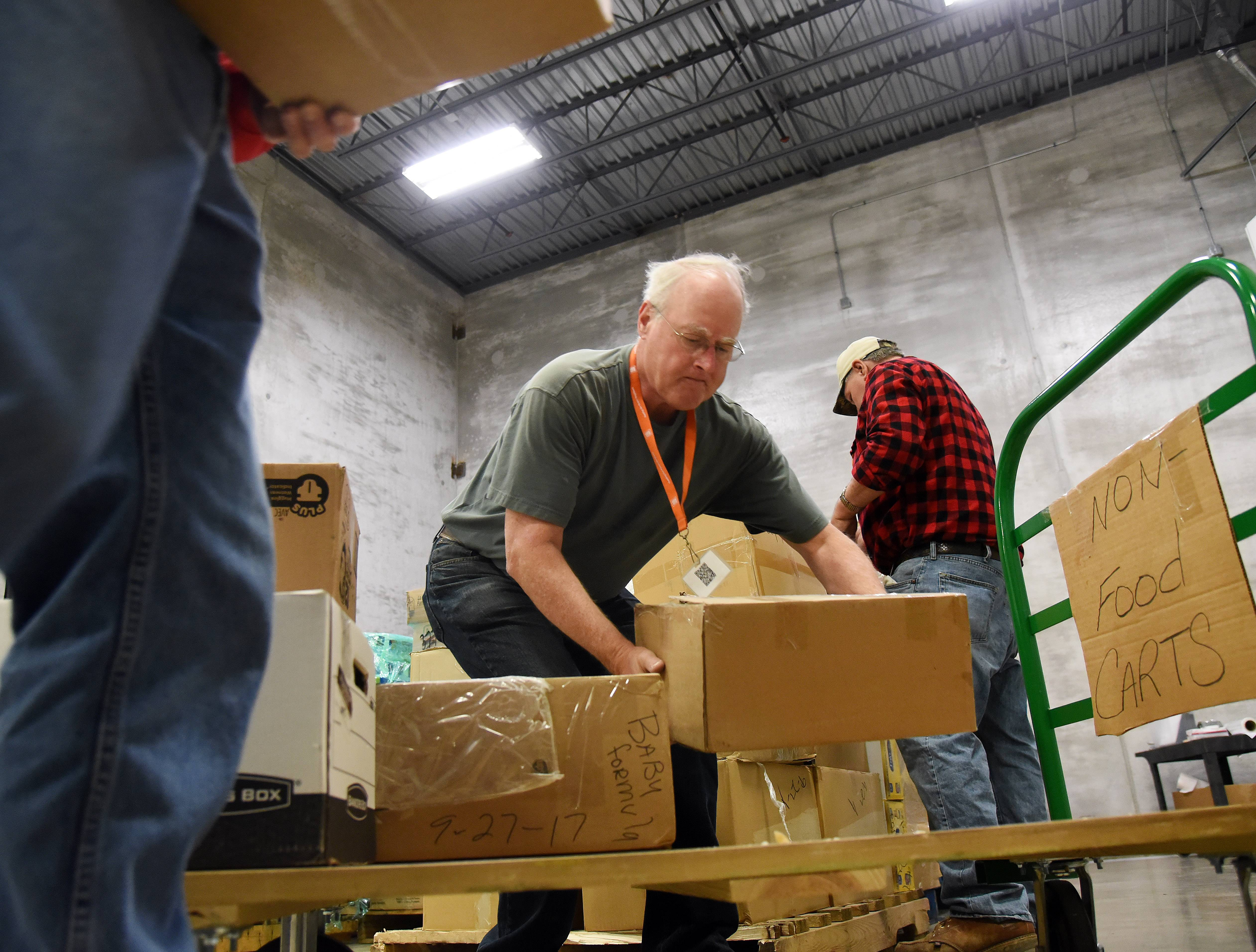 Jim Lipsett of Batavia and other volunteers at the Northern Illinois Food Bank sort through donations that will be sent to hurricane victims in Puerto Rico.