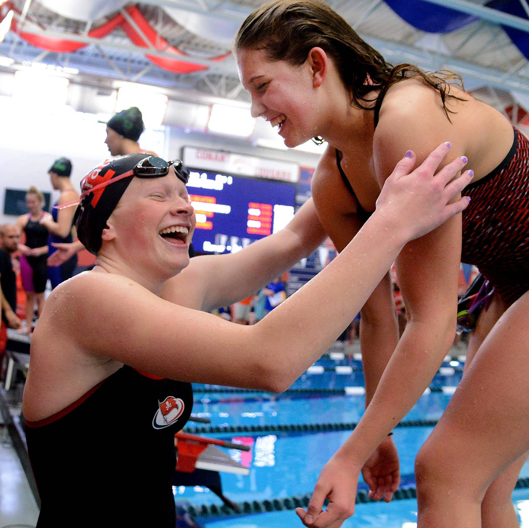 Jane Smith of Palatine, left, celebrates with Becca Galovich of Barrington after the 200-yard freestyle in the Mid-Suburban League meet. Both will be trying to earn their second straight state meet appearances with qualifying performances in Saturday's sectional meet at Barrington.