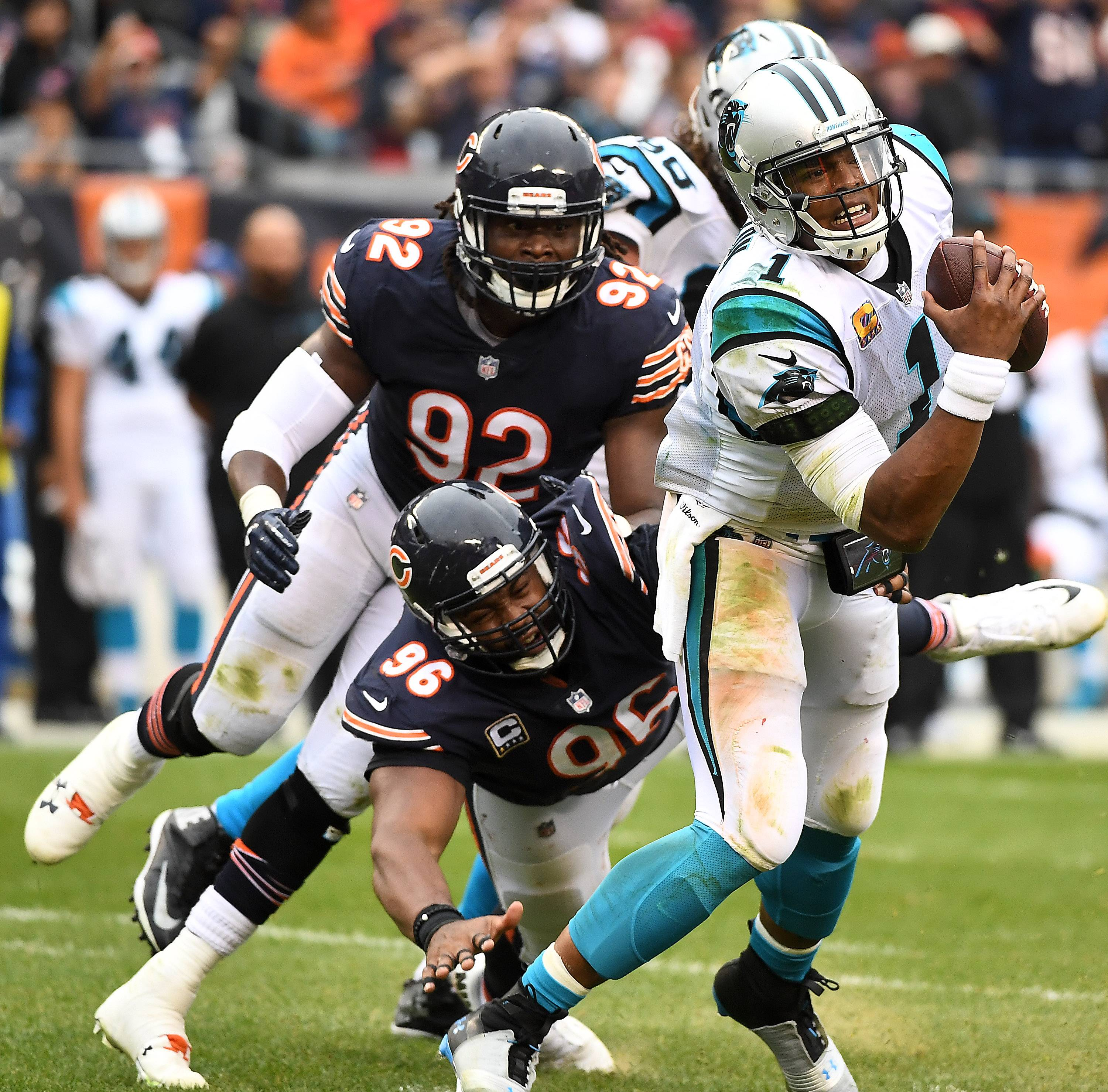 Rick West/rwest@dailyherald.com Chicago Bears defensive end Akiem Hicks (96) and outside linebacker Pernell McPhee (92) close in on Carolina Panthers quarterback Cam Newton (1) during Sunday's game at Soldier Field in Chicago.