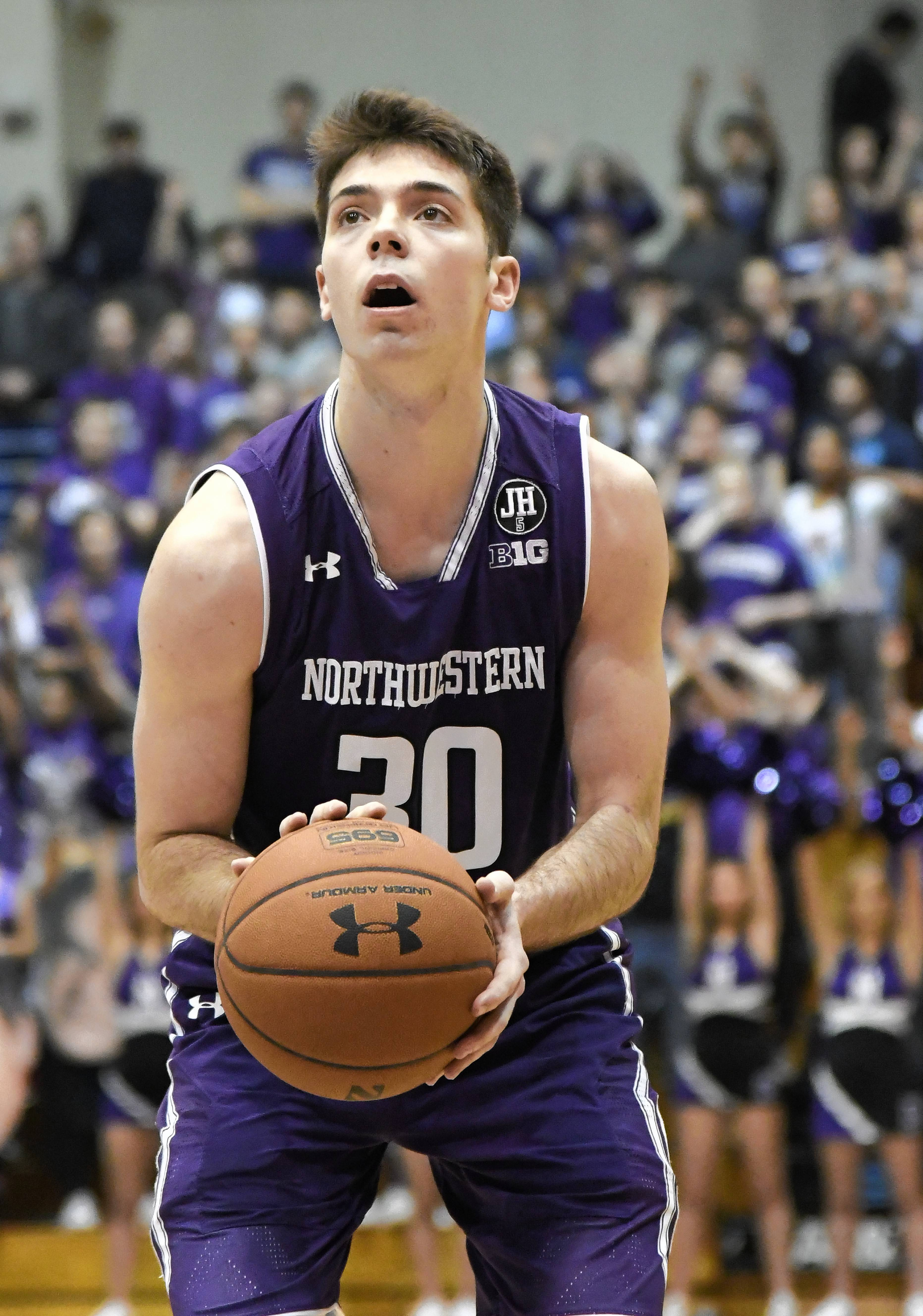 Northwestern guard Bryant McIntosh (30) shoots free throws against Illinois during the second half of an NCAA college basketball game Tuesday, Feb. 7, 2017, in Evanston, Ill. Illinois won 68-61. (AP Photo/David Banks)