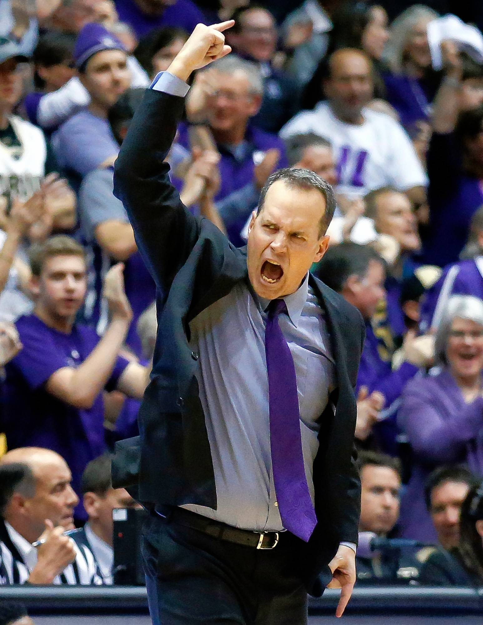 Northwestern head coach Chris Collins reacts after guard Bryant McIntosh scored a basket against Purdue during the second half of an NCAA college basketball game, Sunday, March 5, 2017, in Evanston, Ill. Purdue won 69-65.