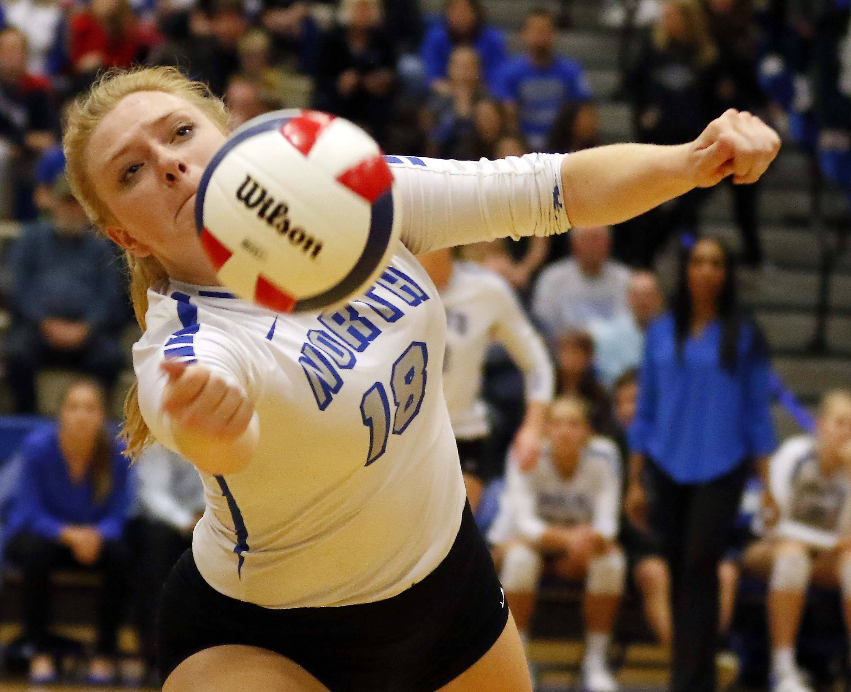 St. Charles North's Cassandra Johnson (18) Friday in the Geneva volleyball supersectional.