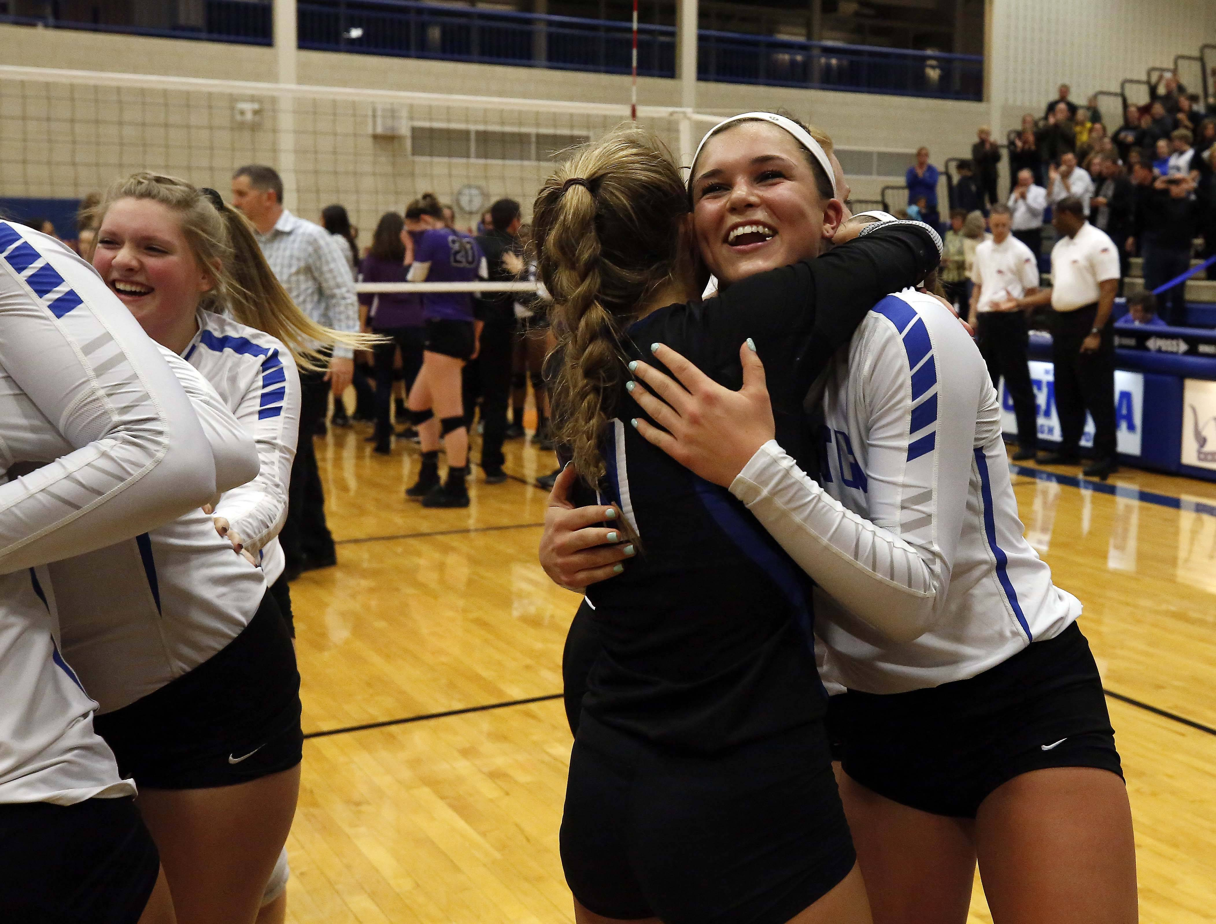 St. Charles North celebrates defeating Downers Grove North Friday in the Geneva volleyball supersectional.