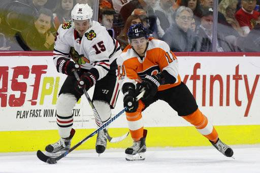 Philadelphia Flyers' Travis Konecny, right, and Chicago Blackhawks' Artem Anisimov vie for the puck during the second period of an NHL hockey game, Thursday, Nov. 9, 2017, in Philadelphia.