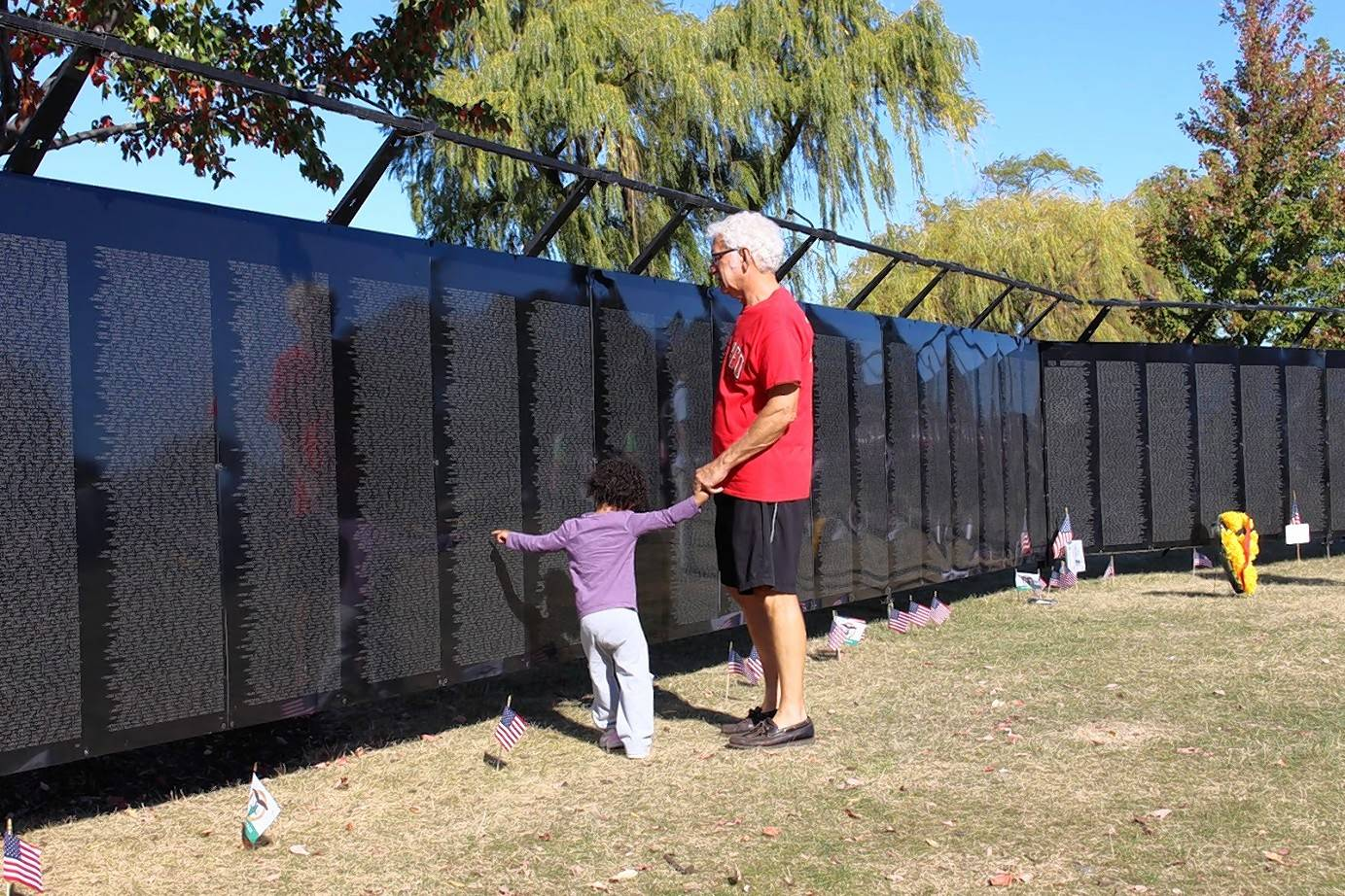 As part of an Oakton service project, Vietnam veteran Les Durov of Des Plaines documented visitors to the Wall that Heals, a traveling half-size replica of the Vietnam Memorial in Washington, D.C.