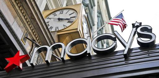 This Tuesday, May 2, 2017, photo shows corporate signage at Macy's flagship store in Manhattan, in New York. Macy's Inc. reports earnings Thursday, Nov. 9, 2017.